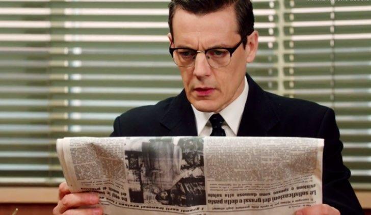 Il paradiso delle signore Luciano legge il giornale per trovare il punto debole di Oscar Credits RAI